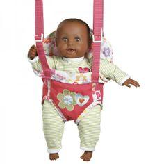 Deze getinte babypop heeft mooie bruine ogen is lekker zacht. Ze heeft een pyjamaatje aan en ruikt naar babypoeder. Ze is 38 cm. groot. De pop heeft een lachmechanisme dat verwijderd kan worden en wordt geleverd met een draagzakje en een magnetisch speentje.Adviesleeftijd vanaf 2 jaar.
