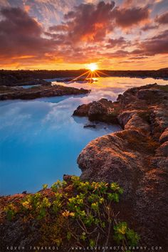 Beautiful sunrise in the Blue Lagoon in Iceland. They say the blue colours of the geothermal lagoon water are like nothing you have ever seen in your life.