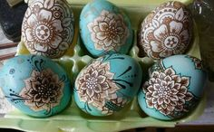 Eggs by Kim Maser.  Brown eggs dyed dark brown.  Washed back, etched waxed and blue added last.  So beautiful.