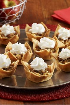 Mini Apple Pies - This easy mini tart recipe is simple to make with fresh apple, cinnamon and almond crumble tucked inside pastry cups. A perfect Christmas or Thanksgiving recipe - pie without the hassle!