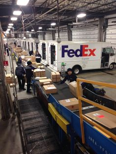 FedEx vans line up at a sorting centre General Worker, Umbrella Company, Parcel Delivery, Fedex Express, Cargo Airlines, Future Jobs, Dream Studio, Sorting, Stickers