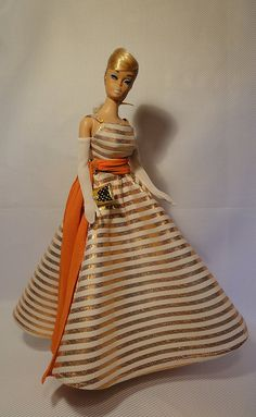 Vintage Swirl Barbie in Holiday Dance - mid 60's  . I have this dress but with a green sash :)
