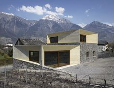 Charrat Transformation: clavienrossier.  Geneva studio clavienrossier created this home in the Swiss Alps by adding two tinted concrete volumes atop the remains of a stone house and adjacent barn.