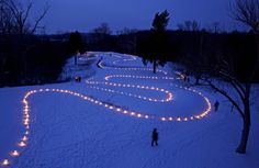 The Serpent Mound in Adams County, Ohio is outlined with 900 luminarias to mark the winter solstice
