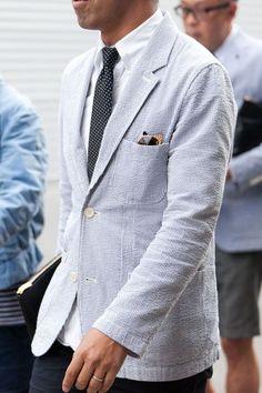 Seersucker. Two buttons. Sunglasses in pocket