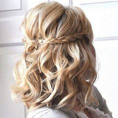 Half up half down braided wedding hair style for short hair.