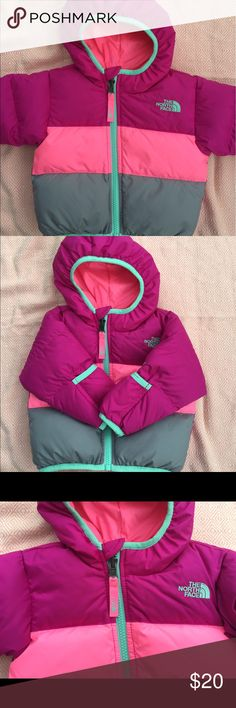 North Face reversible baby puffer jacket 6-12mo It's like getting two coats in one! Barely used North Face puffer for baby. Has hand warmers built in. Near perfect condition. Cute as a button! North Face Jackets & Coats Puffers