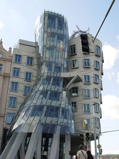 """The Dancing House  Also nicknamed """"The Drunk House"""", is a downtown office building in Prague, in the Czech Republic, and was designed by Czech architect Frank Gehry. Notable features include a French restaurant on the roof, with wonderful views of the city."""