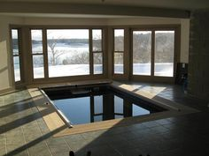 Winter light runs stark shadows across this neutral tones of this sunroom Endless Pool® installation. For more ideas, visit http://www.endlesspools.com/tour-sunroom-pools.php.