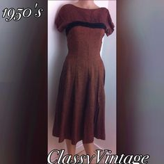 1950's raw silk stunning brown dress Beautiful raw silk in a rusty brown. Back zipper and short sleeves with a flared skirt. Black velvet detail in front and  back. No rips tears or stains. Size four manikin that is five foot six. Fits her perfectly and no give in fabric. vintage 50's Dresses