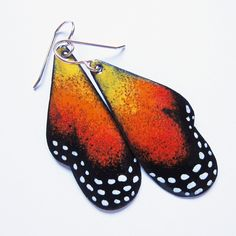 Express your love of nature with unique original enamel butterfly earrings, rendered in painterly detail. Inspired by the monarch butterfly, these earrings are hand-painted in colorful shades of yello Wing Earrings, Clay Earrings, Polymer Clay Jewelry, Dangle Earrings, Enamel Jewelry, Jewelry Art, Jewelry Design, Bohemian Jewelry, Jewelry Gifts
