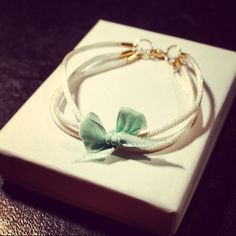 Beautiful three satin strings bracelet with  a mint colour bow on it <3