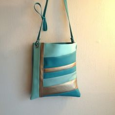 A personal favorite from my Etsy shop https://www.etsy.com/listing/273640868/cross-body-vinyl-vegan-bag-in-mint-teal