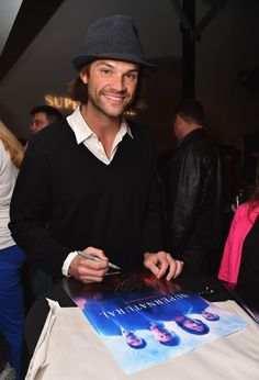 I owned that calendar he is signing.