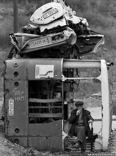 Taking a break in a burned out bus used as a sniper barricade. http://www.bbc.co.uk/news/in-pictures-13613839