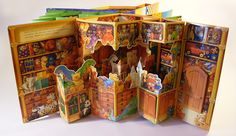 Paul Stickland's carousel pop up book The Christmas Workshops on Paul Stickland's website.  #childrensbooks #popupbooks