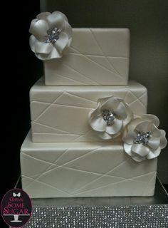 White and modern squared wedding cake with fondant flowers www.gimmesomesugarLV.com