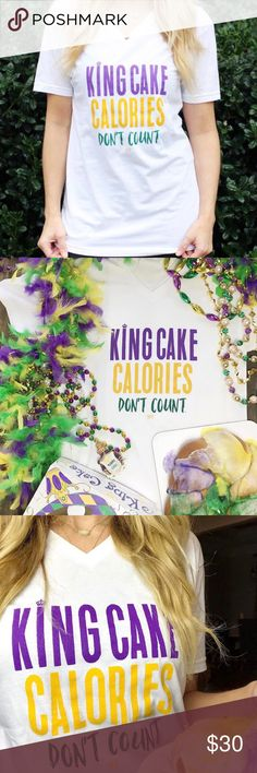 King Cake Mardi Gras New Orleans boutique Tshirt Brand new boutique King Cake Calories Don't Count t-shirt. Perfect for New Orleans Mardi Gras Carnival season. Be festive and funny with this perfect southern tee. New Year's Resolutions? No problem! Because everyone knows King Cake calories don't count! Show your love of this iconic Louisiana treat in our King Calories Don't Count white T-shirt!  Poly/Cotton Unisex White Tops Tees - Short Sleeve