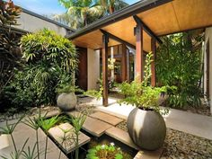 Gorgeous covered walkway and water feature for a japanese inspired garden.