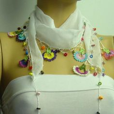 Crocheted WHITE scarf with handmade multi color oya flowers. $17.00, via Etsy.