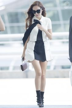Jessica at the airport. She is wearing Valentino, I love it.