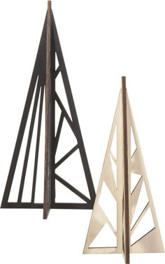 branch out. Abstract evergreens grow architectural in black or natural plywood. Angled with graphic cutouts, geometric panes simply notch together to freestand a 3D tree. Takes root on the table or mantel. PlywoodMatte black or natural finishShips flat and notches together to form a 3D treeWipe cleanMade in China.