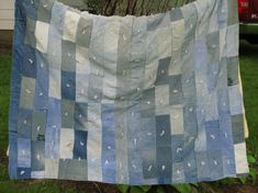 """Denim comforter made from old jeans.  Reverse side is cotton flannel and can be filled with quilt batting or repurpose an old blanket that needs a new use.  Measures 70"""" by 50"""".  Patches are 6"""" by 3"""" with a 2"""" border at the top."""