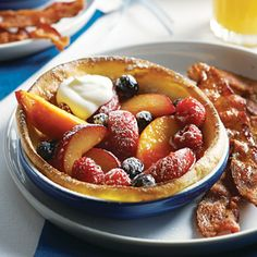 "Lovely - this looks great.  ""Puff Pancakes with Maple-Baked Fruit"".  It has step by step instructions with pictures."