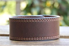 CUSTOM HANDSTAMPED brown leather cuff with stitching by mothercuffer on Etsy