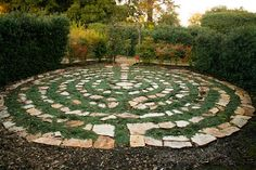 A garden labyrinth of hand-laid stone weaves a circular pathway through a bed of creeping elfin thyme in Napa, California.