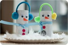 snowman toilet paper craft | Toilet paper tube snowmen with earmuffs made out of pipe cleaners and ...