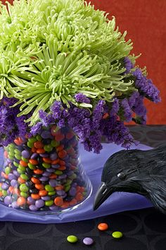 place a smaller vase inside of a larger vase and filled the space between the two vases with Halloween MM's. The arrangement features chartreuse spider mums and purple statice. Could be done with candy corn. Halloween Signs, Holidays Halloween, Vintage Halloween, Halloween Crafts, Pretty Halloween, Vintage Witch, Vintage Holiday, Halloween Stuff, Halloween Halloween