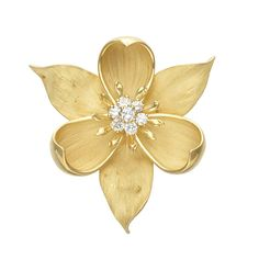 Gold and Diamond Flower Pendant-Brooch 18 kt., 7 round diamonds ap. .65 ct., ap. 15.3 dwts.
