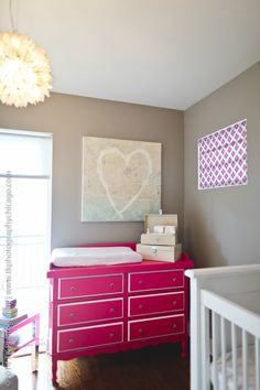This pink Celine dresser from @Newport Cottages is so great in this mod gray nursery!