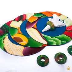 Bring color to your table with these charger plates, hand-painted with a colorful vegetable motif! #SALE #CyberWeekend | Trae color a tu mesa con estos fondos de plato pintados a mano con coloridos vegetales
