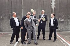 is this bridesmaids outside the frame chucking their bouquets at the groomsmen?  if so, genius and hilarious.