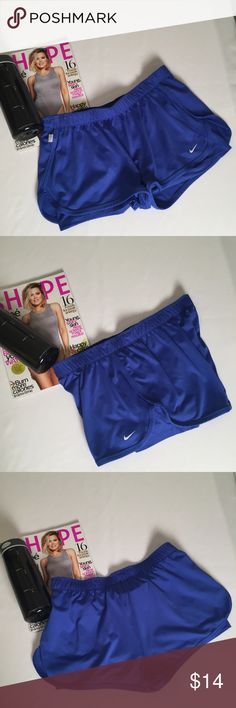 Nike dry fit tennis /exercise shorts Nike ladies size large exercise/tennis shorts. They are DRI FIT and have a spandex shorts liner inside of shorts.  They have an elastic waist.  Excellent condition Clean and ready to wear. No stains, snags or damage  Comes from a pet free smoke free environment.  Not the right size , color or style you're looking for check out Molly's closet.  Thanks for Looking Molly  M159/W.50 Nike Shorts