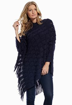 Get wrapped up in this cute navy fringed poncho!! Lightweight, soft and cozy!