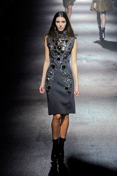 Then came the bejeweled babes, a parade of suits, coats and dresses each more embellished or embroidered than the last. Through it all, Elbaz emphasized the waist, whether the entire look was skimming or flared.   - HarpersBAZAAR.com