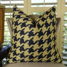 The front fabric of this beautiful accent #pillow is a blend of rayon, cotton and polyester in navy and taupe colors; at $ 121.00