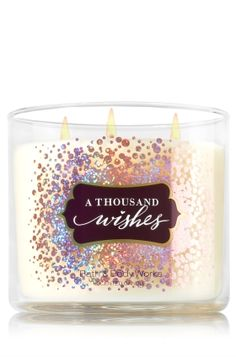 "A Thousand Wishes - 3-Wick Candle - Bath & Body Works - The Perfect 3-Wick Candle! Made using the highest concentration of fragrance oils, an exclusive blend of vegetable wax and wicks that won't burn out, our candles melt consistently & evenly, radiating enough fragrance to fill an entire room. Topped with a flame-extinguishing lid! Burns approximately 25 - 45 hours and measures 4"" wide x 3 1/2"" tall."