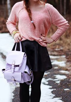 Stuff your gadgets and other thingamajigs in this PU faux leather lavender backpack.