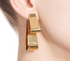 Marni - Fall 2015 - Eardrops in metal with minimalist bows - Two minimalist bows in metal are folded onto themselves at different heights to form a drop earring of sober elegance. One of the two bows is the screw of the earring.