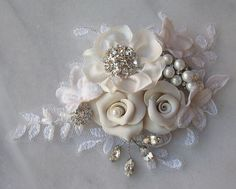 Ivory Bridal Sash, Wedding Belt, Rhinestone and Pearl Flower Sash with Lace - COLETTE. $158.00, via Etsy.
