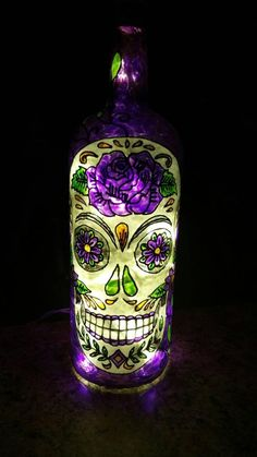 Love Sugar Skulls?! This is an Upcycled Hand Painted Lighted Bottle. You can choose the color, basic colors only. It contains LED Christmas lights so they do not get hot. They make great night lights and/or accent lights. Size is approximately 13 inches tall and 4 inches wide. (750 ml - 1 liter).