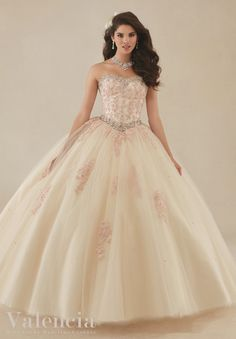 Mori Lee Valencia Quinceanera Dress Style 89086 is made for girls who want to look like a beautiful Princess during her Sweet 15 party. Made out of lace and tulle, this ball gown features a strapless