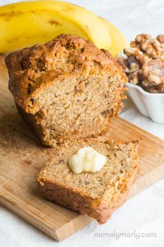 Super moist Vegan Banana Nut Bread that's both egg and dairy free. One delicious slice after another is filled with ripe bananas and walnuts.