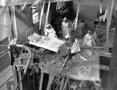 English nurses clear debris from one of the wards in St. Peter's Hospital in the aftermath of a German bombing during the Blitz. Four hospitals were among the buildings hit in one night by German bombs during a full scale attack on the British capital. Stepney, East London, England, U.K. 19 April 1941.