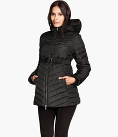 Bargain padded jacket with a hood, a zip at the front, zipped side pockets, soft ribbing at the cuffs, concealed elastication at the hem, and a detachable elastic belt.