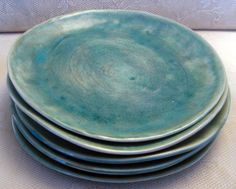 Handmade dinner plates-stoneware clay-pottery-ceramic-hand built-blue-crackle-set of six. $180.00, via Etsy.